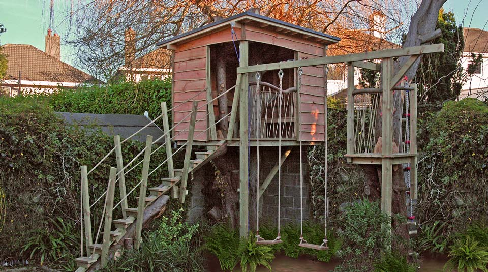 Quirky children's treehouse design, with crow nest and swings