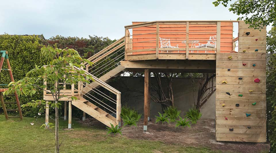 Elevated sea view entertaining deck with climbing wall, a unique structure for all ages
